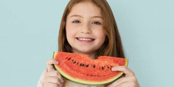 child eating watermelon